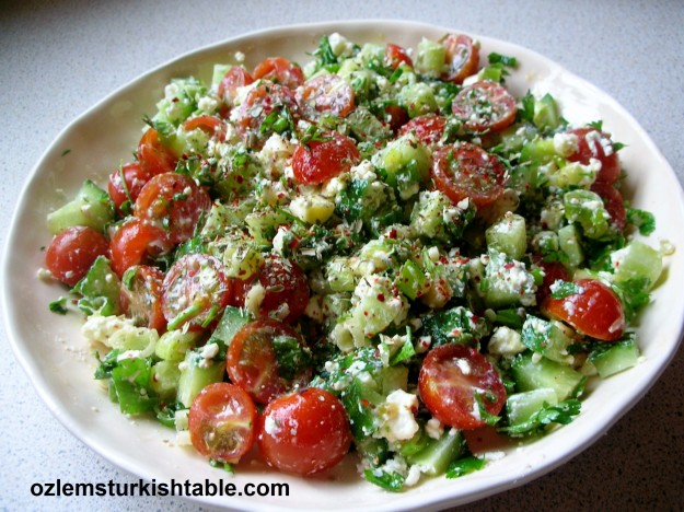 Cokelek Salatasi- crumbled feta with spices, tomato, cucumber and onions