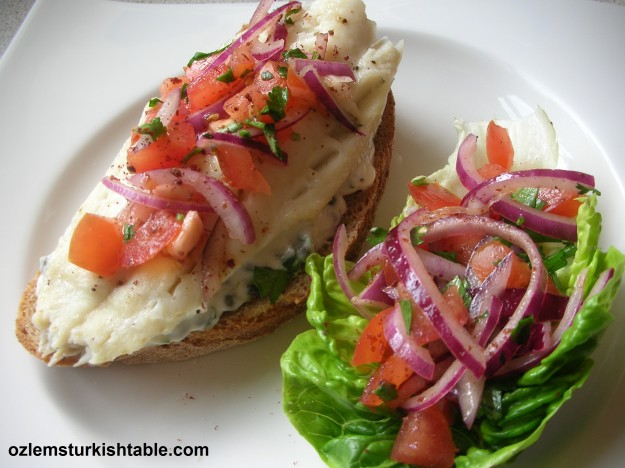 Balik ekmek; Open fish sandwich with herb mayonnaise and sumac, red onion and tomato salad