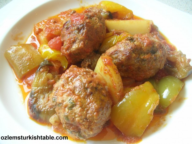 Baked Turkish meatballs with eggplants, potatoes, tomatoes; an all in one delicious dish