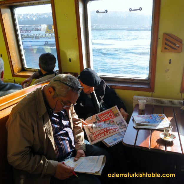 Locals in the ferry reading their papers