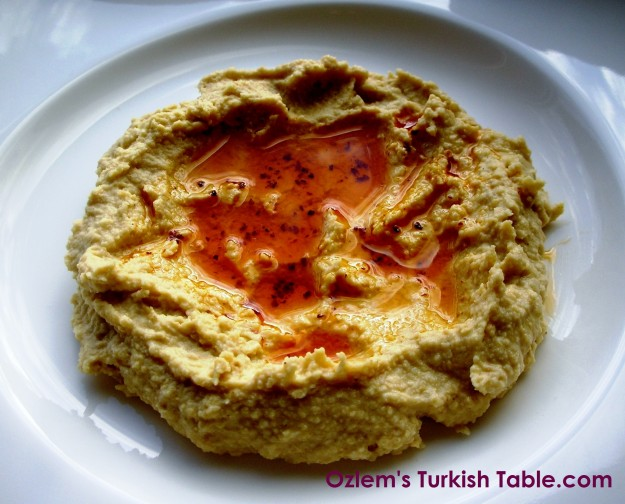 Warm hummus with red pepper flakes infused olive oil - a delicious vegetarian dip.