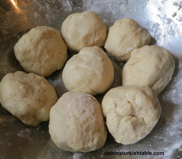 Divide the gozleme dough into  balls, cover with a damp cloth and leave them to rest for 30 minutes,
