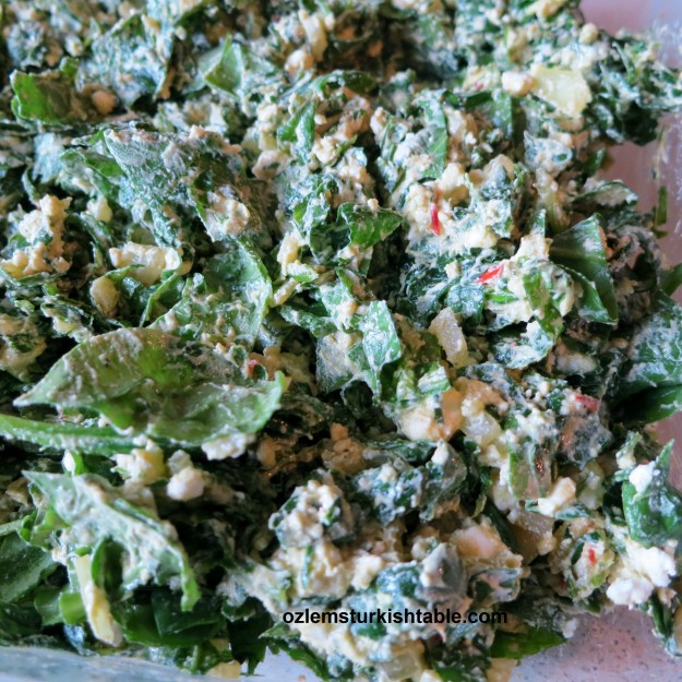Stir in the feta cheese to the spinach mixture and combine well.