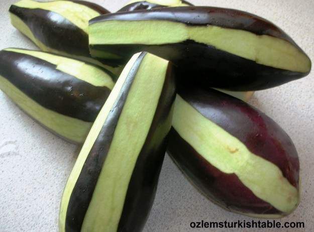 Using a vegetable peeler, peel the aubergines lengthways in zebra stripes.