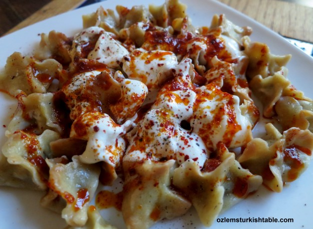 Manti; delicious dumplings with gound meat filling, served with garlic yoghurt ans spices infused olive oil