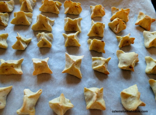 Bake uncovered for 10 minutes, until the manti, dumplings start to get light golden.