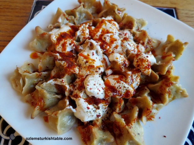 Delicious, tiny treasures, Manti; Turkish dumplings with spiced ground meat filling.