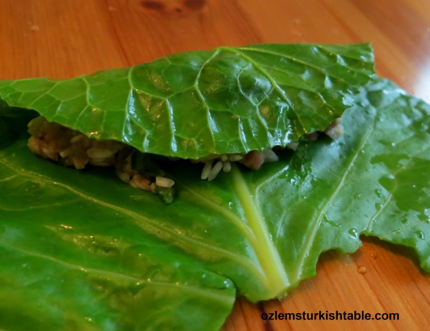 Lay one of the leaves on a flat surface and place 1 tbsp. stuffing.