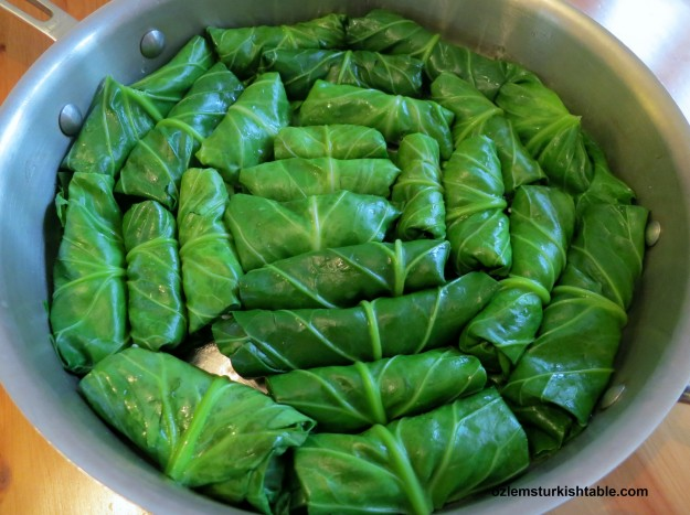 Place the stuffed leaves seam side down in a wide, deep pan.