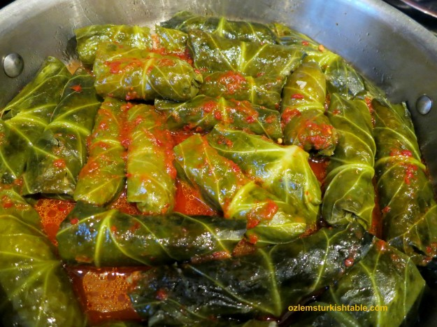 Stuffed winter greens or Swiss chard with ground meat and rice in hot pepper sauce - delicious