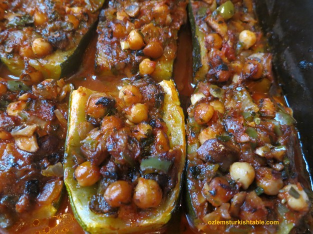 Baked zucchini halves with vegetables & chickpeas; great with garlic yoghurt aside