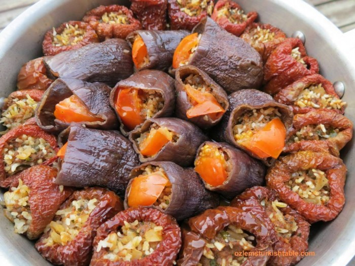 Dried eggplants and peppers, stuffed with ground meat and aromatic rice; kuru patlican dolmasi