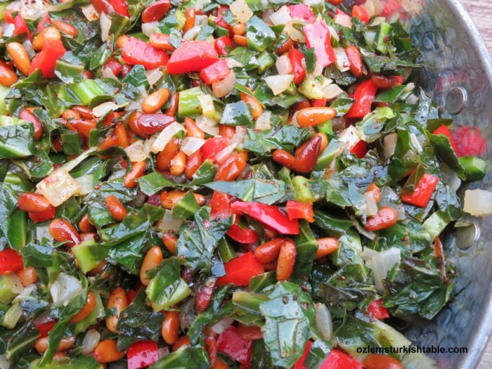 Leafy greens or Swiss chard with onions, peppers and pine nuts, cooked in olive oil