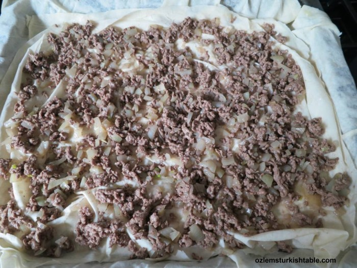 Spread the ground meat & onion mixture over the yufka or filo pastry sheets