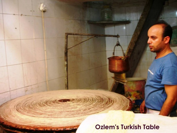 The Master at work in Long Market, Antakya. The dough is pushed through a sieve to form delicate strands, called Tel Kadayif.