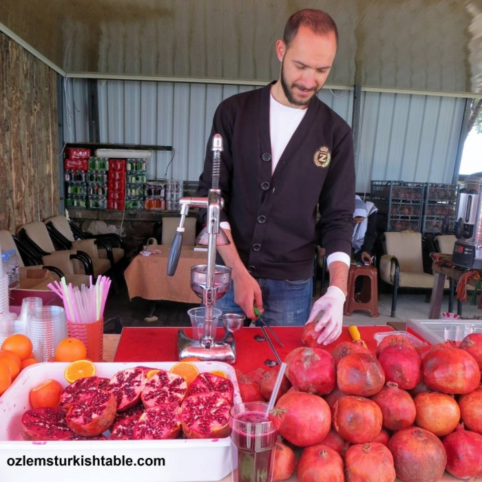 Pomegranates freshly squeezed on a traditional hand held juicer, in Pergamum, Turkey
