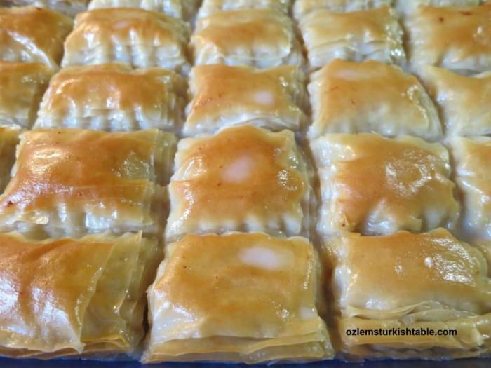 Pour in the luke warm milky syrup over cooled cooked filo pastry and let the pastry to soak the milky syrup for 35- 40 minutes.