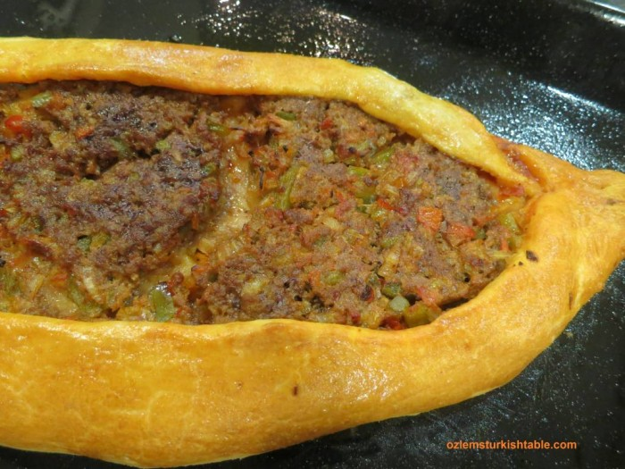 Kiymali Pide; Turkish oval flat breads with ground meat and vegetables topping