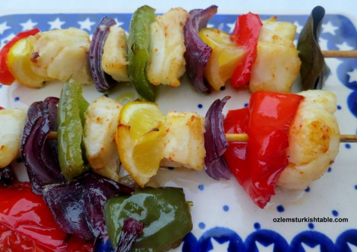 Fish kebabs with roasted vegetables by the side; a delicious, easy meal.