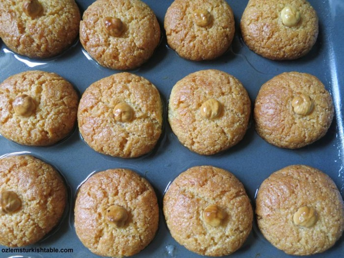 Pour the cooled syrup over hot Sekerpare and let the Sekerpare cookies absorb the syrup as they cool.