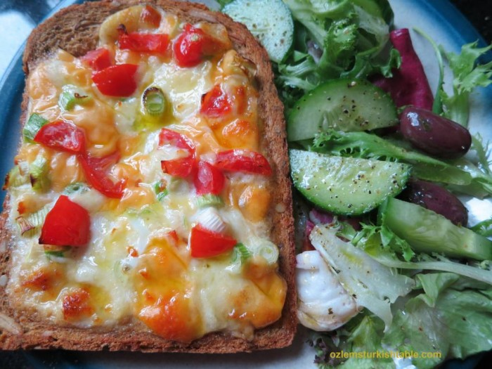 Baked bread with eggs, cheese, spring onions and tomatoes; Yumurtali Ekmek