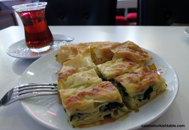 Peynirli Tepsi boregi; cheese and parsley tray bake with fillo sheets; it goes so well with Cay, Turkish tea.