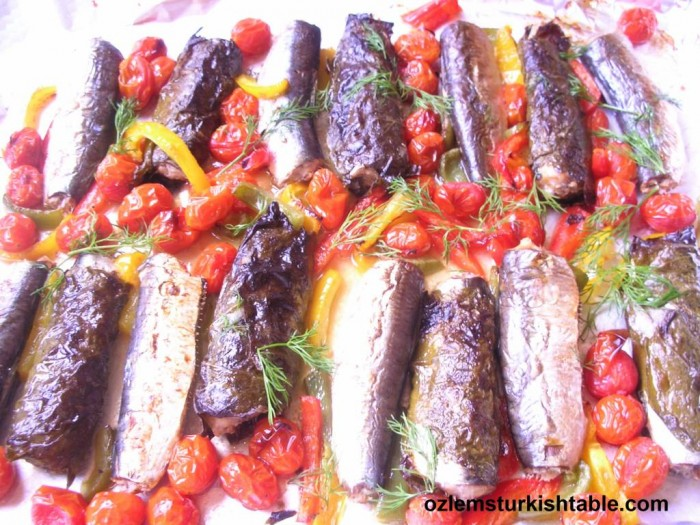 Baked Sardines in vine leaves, with tomatoes and peppers; firinda sebzeli sardalya