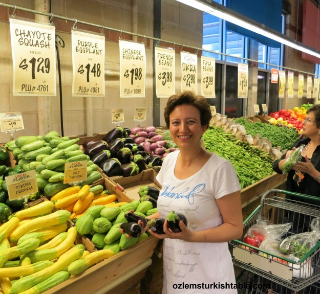Getting the eggplants for our Turkish cooking class at Central Market - Austin; love the fresh produce there.