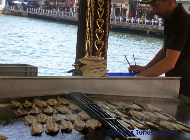 Balik&ekmek; the grilled fish sandwich prepared at the boats is a popular Turkish street food
