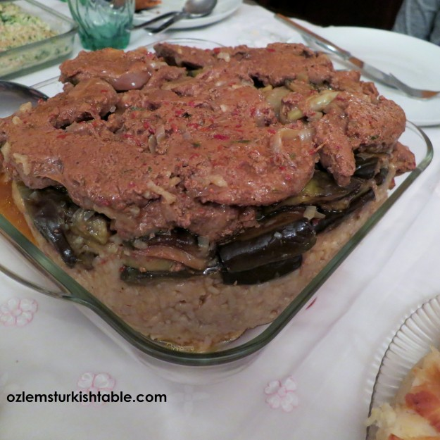 Mevlubi; Upside down rice with marinated meat, eggplants, onions and potato; Southern Turkish way
