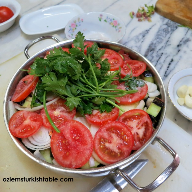 Add the sliced tomatoes and a handful of parsley over the top.