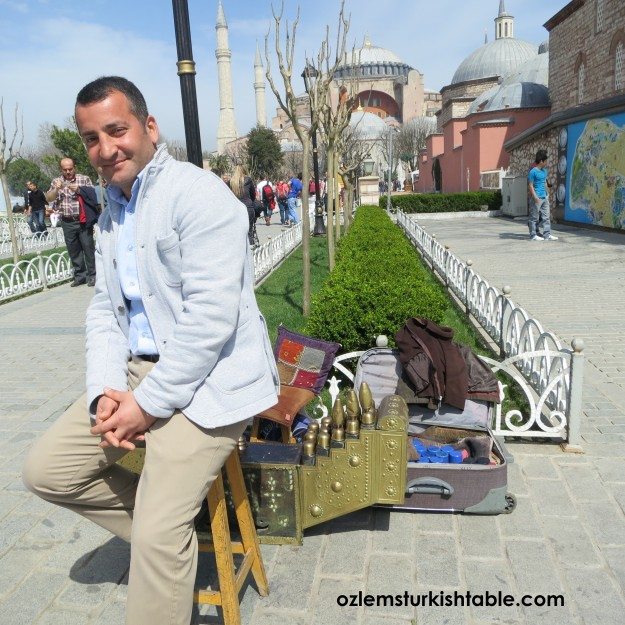 Shoe-shine with a view, over looking the Hagia Sophia