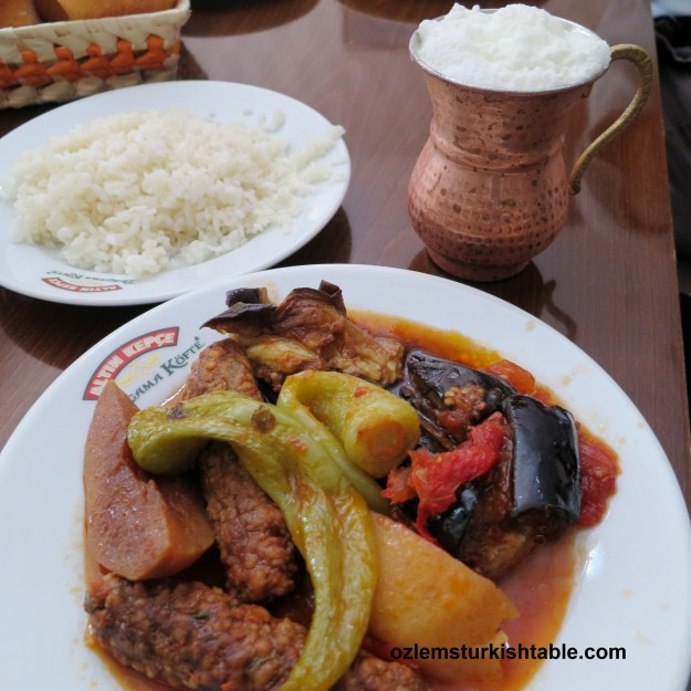 Meatballs with peppers and potatoes, eggplants cooked in olive oil and the ayran (Turkish yoghurt drink) - a delicous feast.