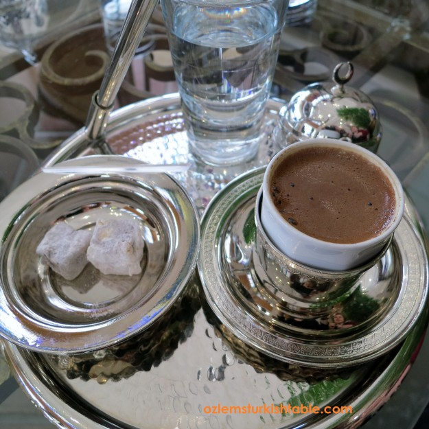 Turkish coffee ritual; a glass of water and Turkish delights accompanies Turk Kahvesi