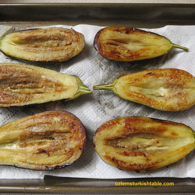 Place the sauteed eggplants on a paper towel to absorb excess oil.