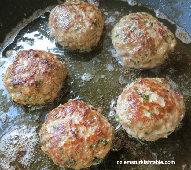 Sizzling, delicious koftes, Turkish meatballs.