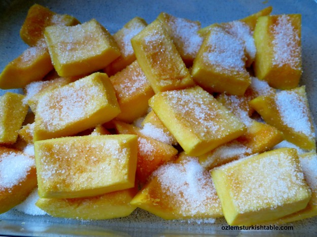 Sprinkle sugar over the pumpkin pieces evenly.