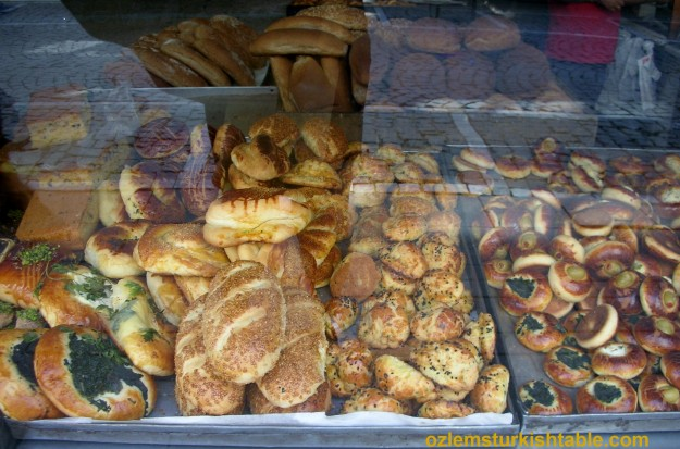 Scrumptious pogacas, savory pastry with cheese, olives and vavious fillings, displayed at a bakery in Istanbul