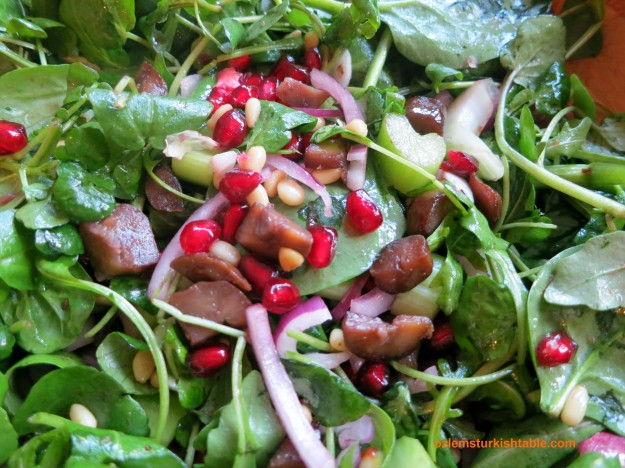 Spinach salad with celery, red onions, sauteed chestnuts and pine nuts; delicious & refreshing