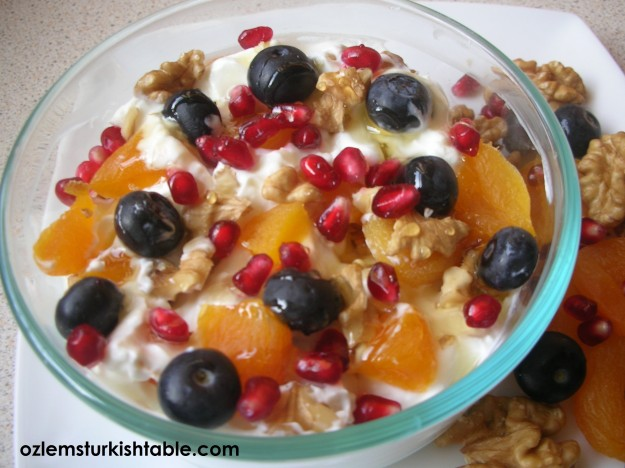 Yoghurt with dried apricots, walnuts, pomegranate and blueberries