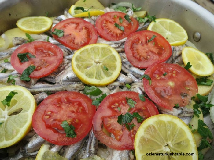 Poached anchovies with vegetables. Hamsi Bugulama