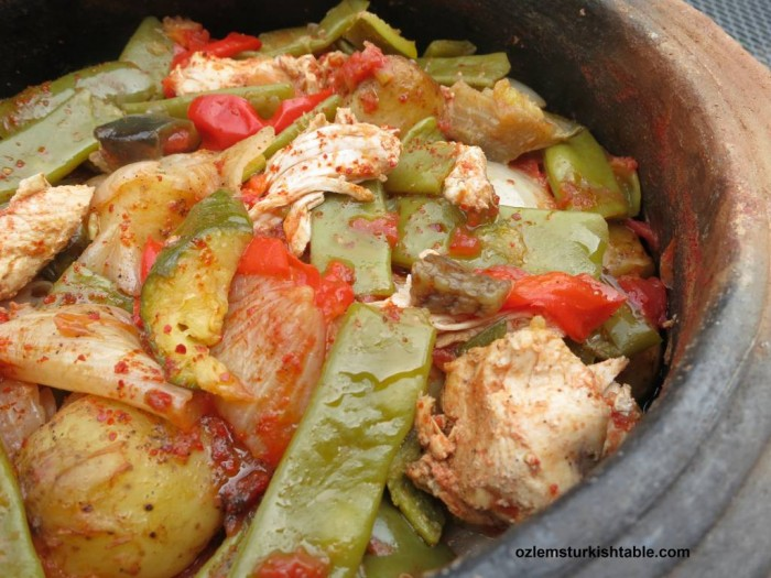 Delicious Tavuk Guvec, Turkish chicken and vegetable stew in earthenware pot