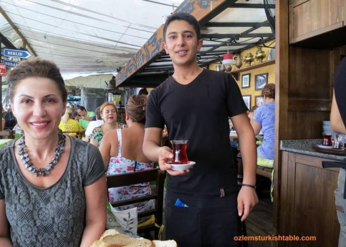 Enjoying a glass of cay and Turkish breakfast at Rumelihisari, Istanbul