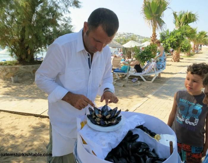Children queuing for stuffed mussels, Midye Dolma in Turgutreis, Bodrum