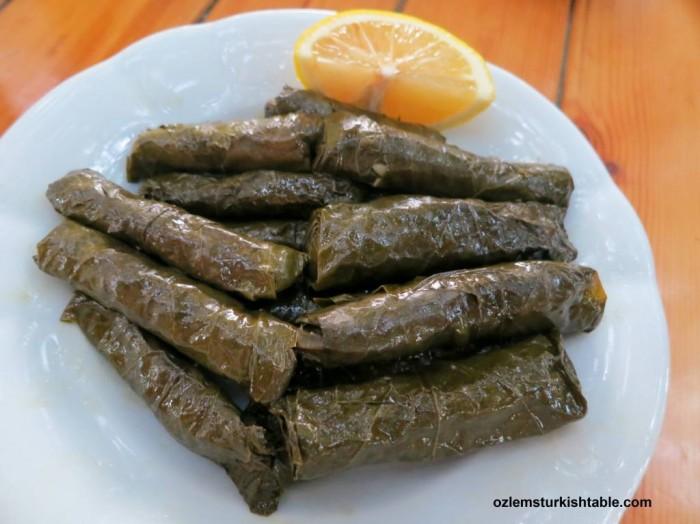 Stuffed grapevine leaves with aromatic rice; Zeytinyagli Sarma