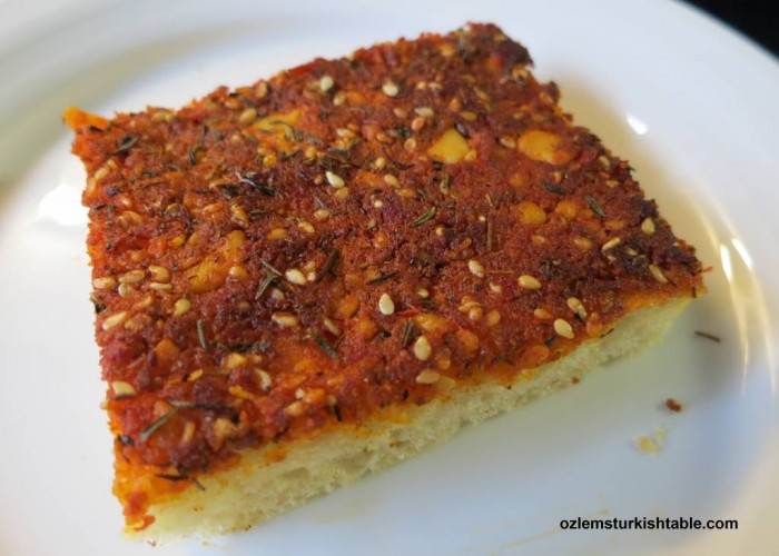 Turkish flat breads with crumbled feta, hot pepper paste, zahtar and sesame seeds, Biberli Ekmek