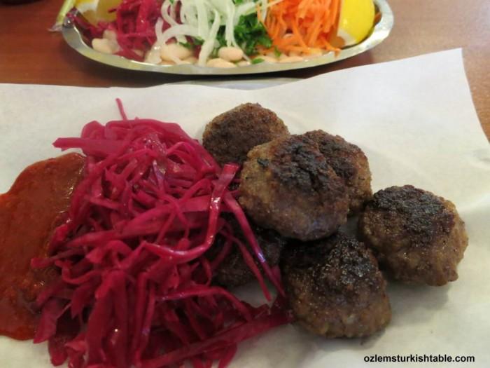 Turkish meatballs, koftes served with piyaz, Turkish bean salad at Kofteci Huseyin