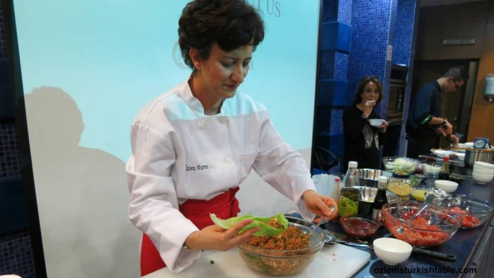 Making kisir, spicy bulgur wheat salad with pomegranate molasses during our Turkish cookery class