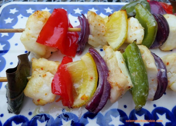 Healthy, delicious fish kebabs in olive oil, lemon juice and red pepper flakes marinade.