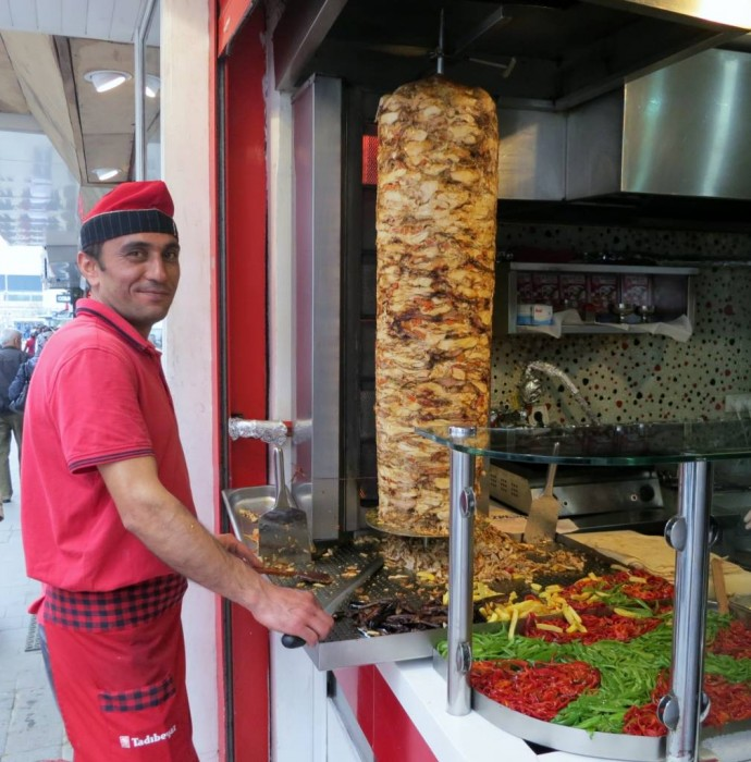 Traditional doner maker in Istanbul, making chicken (tavuk) doner